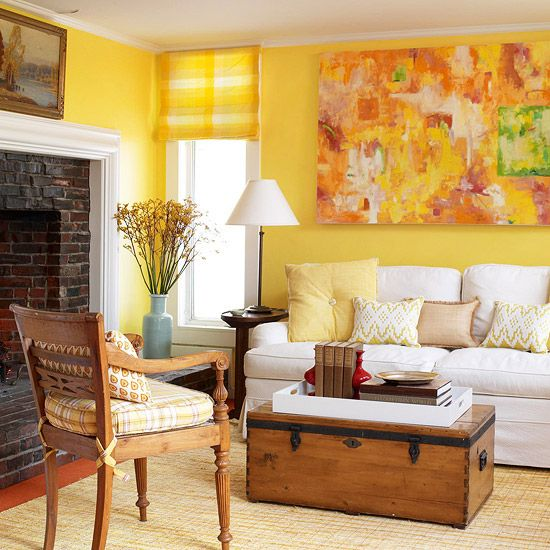 Family Room - This space is pure sunshine that radiates with joy form wall to wall. But what I would love the most are the beautiful wooden chair and the rustic oversized brick fireplace. They compliment the warmth of this cozy space.