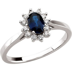 A Blue Sapphire is Surrounded by 12 Sparkling Genuine Diamonds set in a 14k White Gold setting $699.99. #sapphire ring #sapphire_and_diamond ring