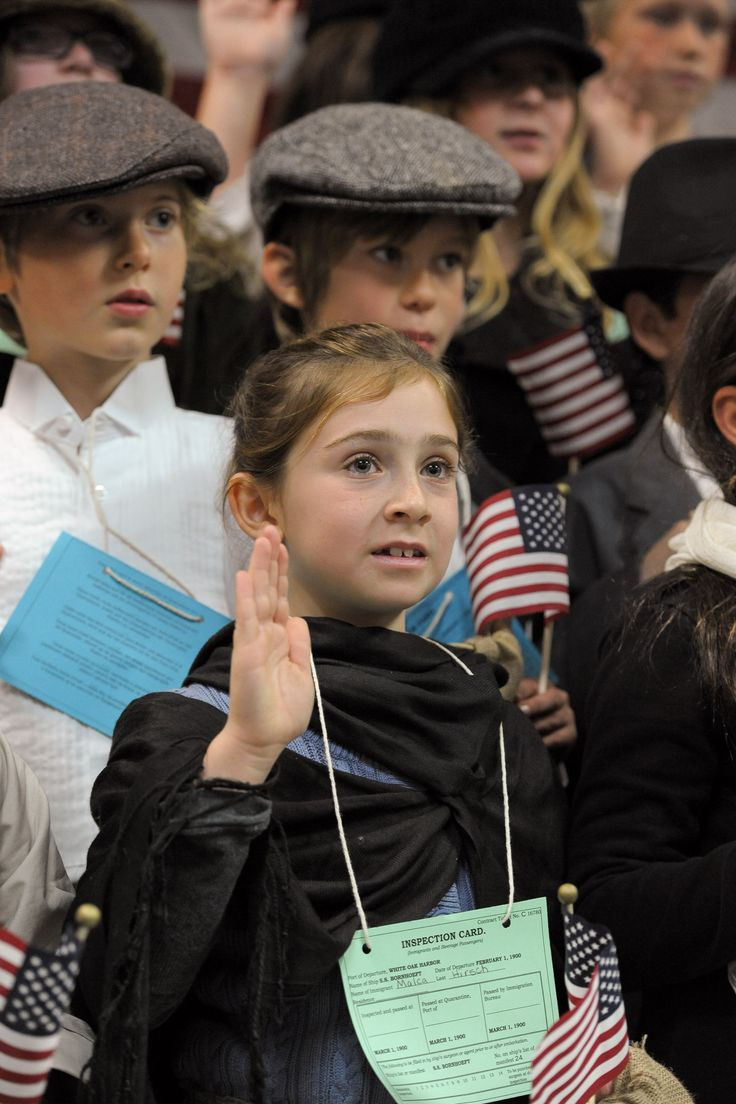 LAST STEP TO CITIZENSHIP - Genevieve Buccieri recites the oath of citizenship while participating in White Oak Elementary School's Ellis Island simulation in Westlake Village on Fri., March 1. MC 137