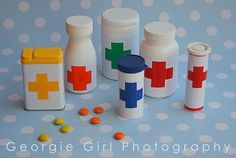 Pretend play Doctor Kit (we'll use small, colorful craft pom poms for the medicine)