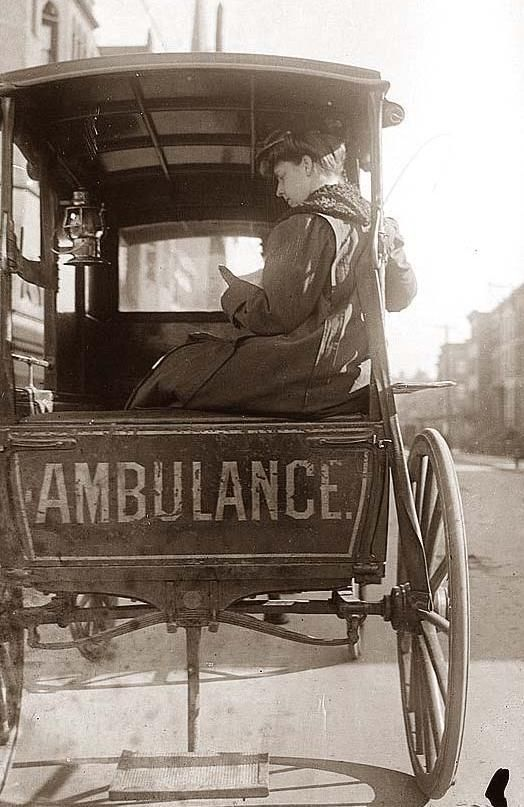 Dr. Elizabeth Bruyn, sitting in the back of a horse drawn ambulance. Dr. Bryun was an ambulance surgeon in New York City in the early 1900's.