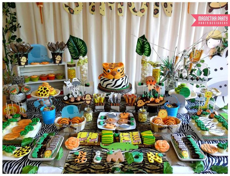 What an amazing jungle baptism party dessert table! See more party planning ideas at CatchMyParty.com!