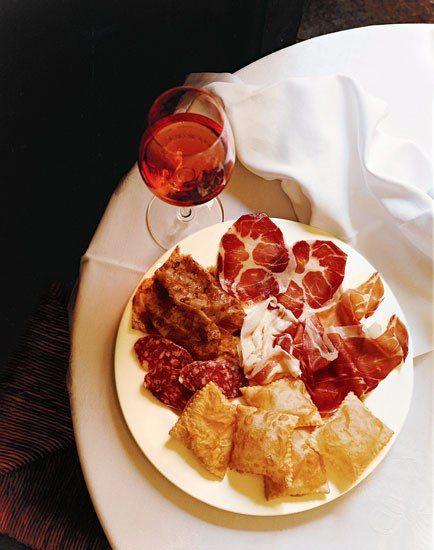 Prosciutto, coppa, and gnocco fritto served with Lambrusco in Modena's Hosteria Giusti, Mario Batali's favorite restaurant in all of Italy.