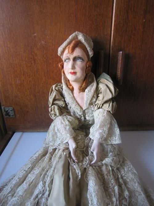 """ITEM NO 447  Wow, here is something super rare for the serious doll collector """" A French Boudoir Doll """", (or vamp,flapper, wobblies, hoopla girl and bye bye kitties were other names given) these were were produced in the 1920's to 30's for the affluent victorian ladies, and if you were anybody you had to have one of these lounging on your bed or somewhere prominant in your bedroom."""