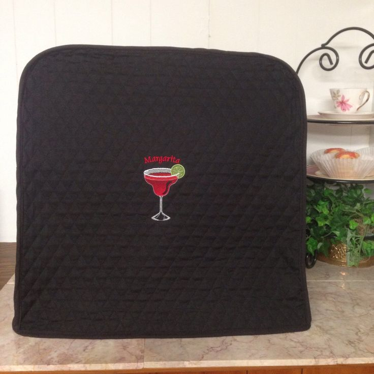 This cover is a wonderful collaboration of ideas and talent.  The customer knew she wanted a margarita glass embroidered on her margarita machine cover.  My Etsy embroidery shop partner, Sanity's Boutique, located a pattern and did the machine embroidery.