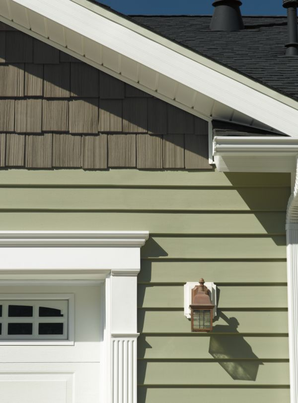Plank Vinyl With Wood Shingle Style Accent White Trim And Decorative Garage Door Wring Frame