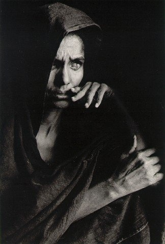 Sebastião Salgado - what a face - such a mixture of sorrow and despair and, I think, desire - desire to escape whatever hell she is facing.