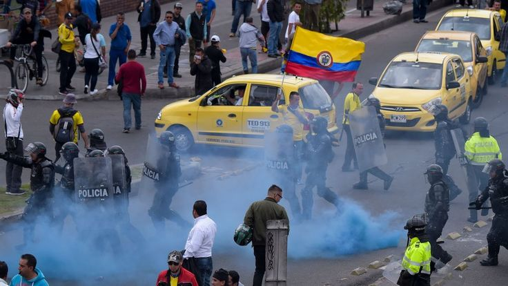 Bogota taxi drivers block streets in Uber protest https://tmbw.news/bogota-taxi-drivers-block-streets-in-uber-protest  Thousands of taxi drivers in the Colombian capital Bogota have blocked roads and clashed with police in protest at hail services such as Uber.Yellow cabs lined the streets of the city on Monday as drivers objected to what they said was an unfair advantage awarded to app-based services.The protesters are calling for more regulation on technology companies like Uber and…