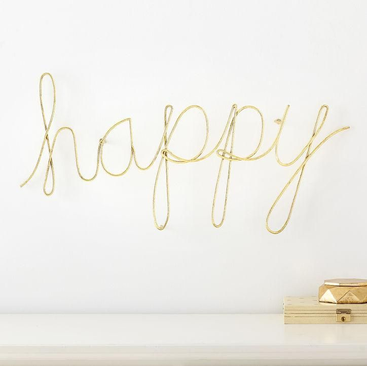 """A golden wire hanging that spells out """"happy"""" in beautiful cursive script? So sweet. Click for more information and preview pictures from MayBaby by Meg DeAngelis, PBTeen's collaboration with the YouTube star."""