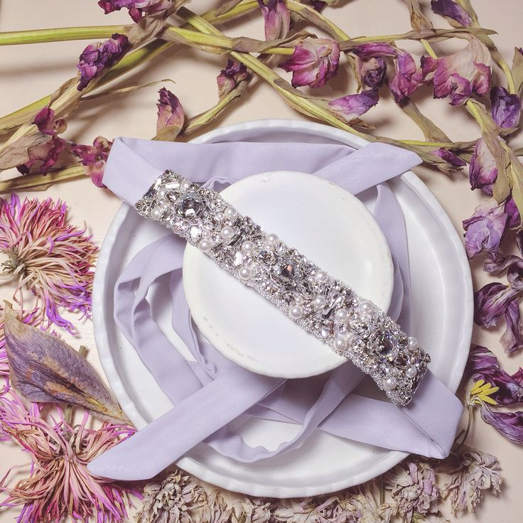 Intricately hand beaded using @swarovski crystals and pearls, this couture embellished tie up sash is a beautiful, delicate and elegant accompaniment to match ones evening gown. #nomikiglynatsiscouture #ngc #couture #redcarpet #vscocam #floral #lilac #swarovski #crystals #whitepearls #exclusive #handbeaded #embellished #maidofhonour #bridesmaid #wedding #bridal #luxury #luxurywedding #beautiful #delicate #elegant #stunning #intricate #sash #belt