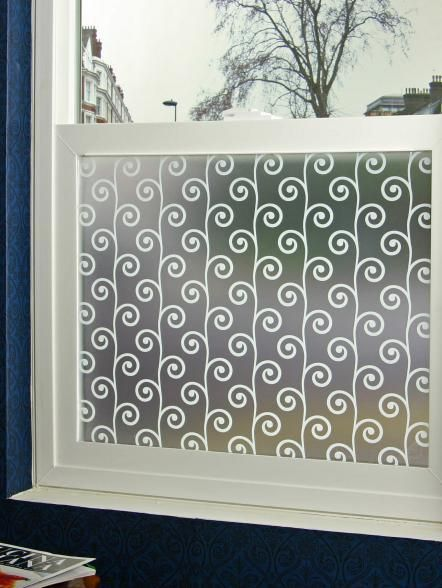Instead of a curtain or valance, consider a designer window film to provide the privacy you're looking for. There are hundreds of designs available, like this one from PureModern. This is a great option for those tiny powder rooms that feel too small even for a curtain.