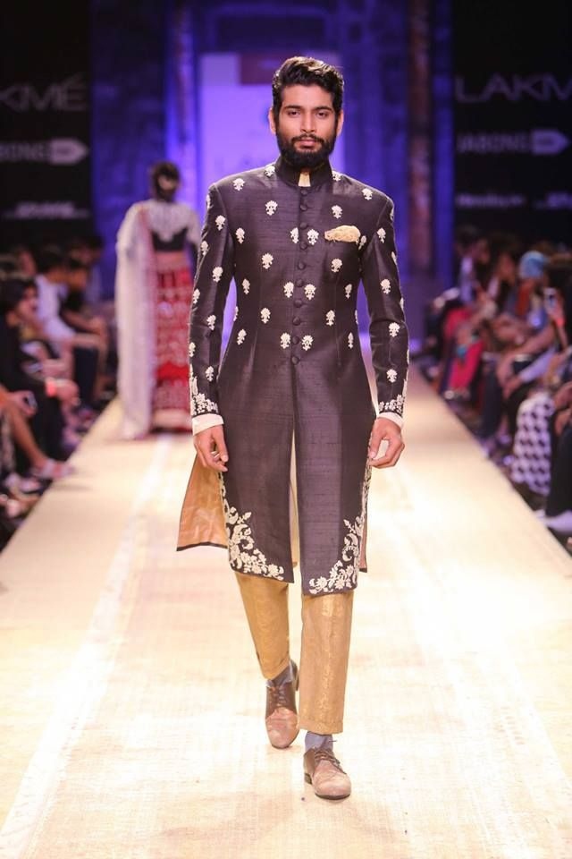 Black and gold Indian men's sherwani by Anju Modi at Lakme Fashion Week Winter 2014. More here: http://www.indianweddingsite.com/lakme-fashion-week-winter-2014-anju-modi-collection/