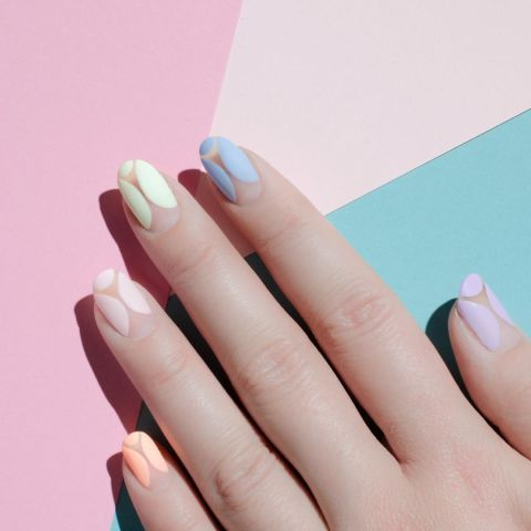 11 matte nail inspiration ideas: On the opposite side of the color spectrum is the matte pastel, seen here in a negative nail design.Design by @palemoonseattle