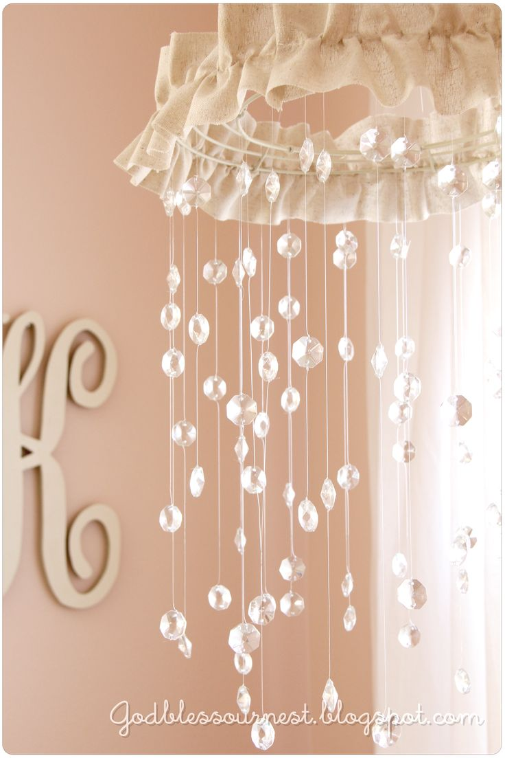 DIY: Crystal Baby Mobile. wire wreath form. HEAVY fishing line. 100-300 glass crystals (if they aren't glass they aren't heavy enough to hold the line down and it wants to curl up) MINUS the burlap. I'd use white tulle.