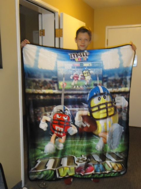 My 2nd oldest with his M&M Football blanket in Vegas...we love football