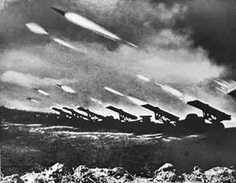 """Photo: a squadron of """"Katyusha""""s firing rockets at the German positions during operation """"Bagration"""". On June 22, 1944, exactly on the third anniversary of German invasion in Russia, the Soviet Army lunched operation """"Bagration"""" to support the Allied landing in Normandy."""