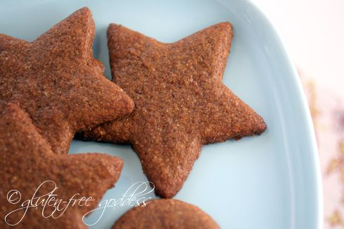 Gluten free vegan gingersnap cookies in star cut out shapes on a plate