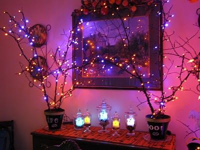 ghostly forest party lights home decor diy halloween party ideas saw some branch like things the dollar store a lil spray paint along with the lights - Halloween Light Ideas