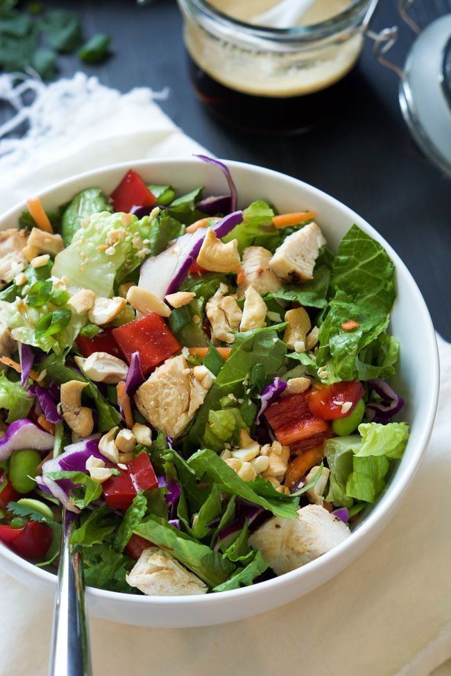 Crispy Thai Cashew Chicken Salad has robust flavors of soy, honey, peanut butter, ginger and red pepper flakes tossed with fresh vegetables, topped with cilantro, green onions and crunch cashews!