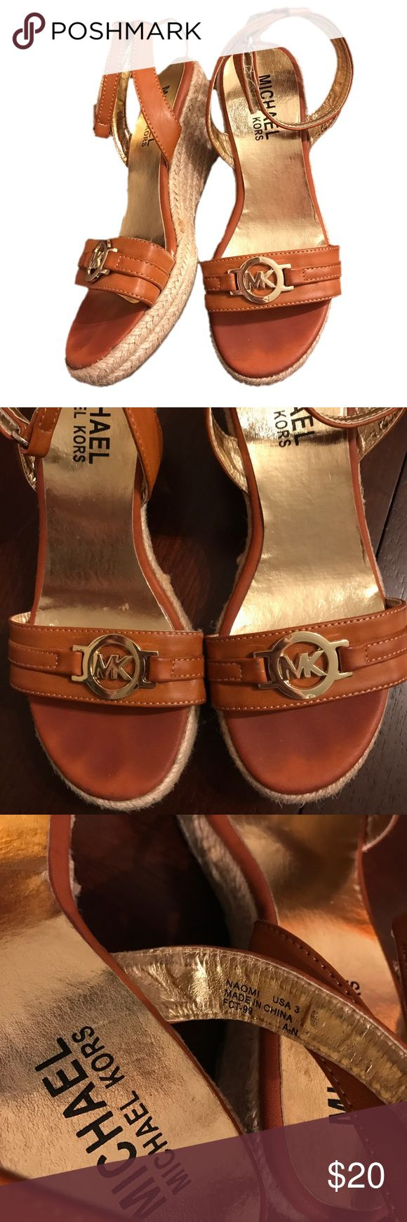 ⭐ Michael Kors size 3 Camel color sandal wedges ⭐ Michael Kors size 3 Camel color sandal wedges. Velcro closure on ankle strap. In very good used condition. Toe imprints where bottom of toes touch shoes and mild wear on heel. Beautiful shoes Michael Kors Shoes Sandals & Flip Flops