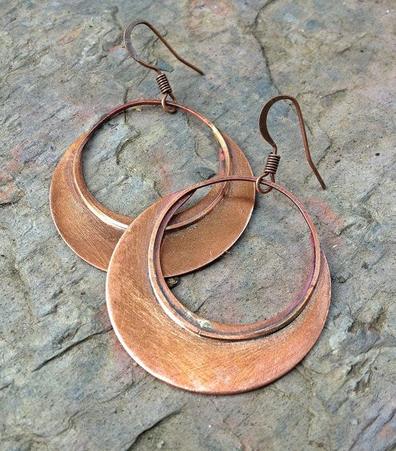 These copper hoop earrings are unique and very light weight! Hand cut and soldered copper with a beautiful lightly oxidized finish. MEMBER - Lammergeier
