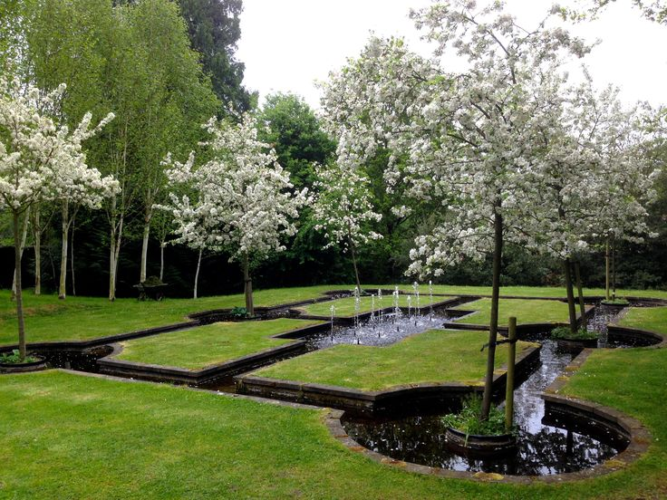 Marylyn Abbott - West Green House, Hampshire | Islamic-inspired 'Paradise Courtyard' with the crab apple, Malus 'Evereste' in full bloom.