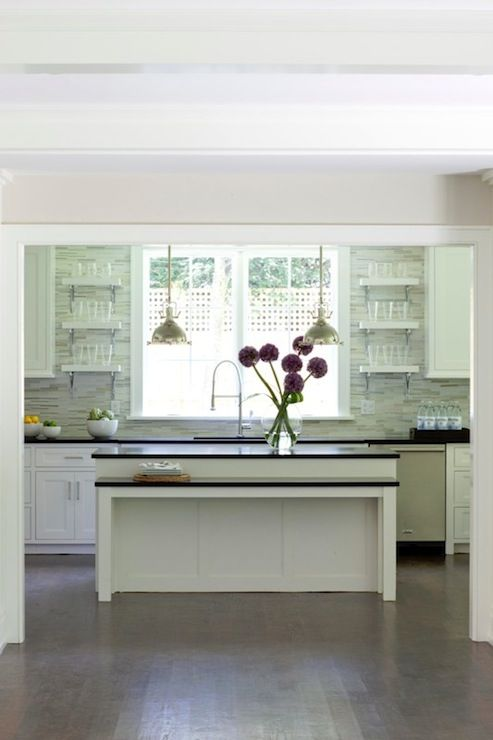 modern white kitchen; linear backsplash; black granite + white floating shelves