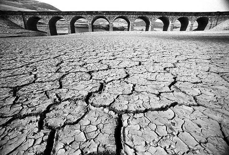 The parched and cracked bottom of Ladybower reservoir, 15 June 1976. In 1976 the highest summer temperatures since records began were recorded in Britain as the country suffered its worst drought for 250 years