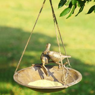 Hanging Lovebird Bird Feeder - These aluminum lovebirds, perched on the side of this hanging bird feeder is sure to be a warm welcome to tho...