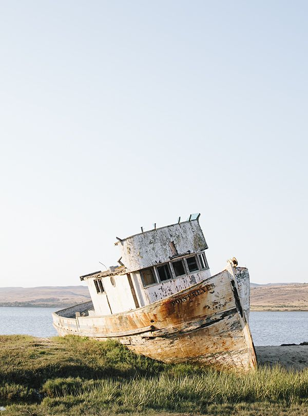 The classic wooden Pt. Reyes Boat, beached in  Inverness, California // WeAreAdventure.us