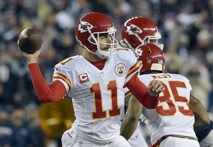 Kansas City Chiefs quarterback Alex Smith (11) delivered a pass against the New England Patriots in the first quarter during the AFC divisional playoff game on Saturday, January 16, 2016 at Gillette Stadium in Foxborough, Mass.