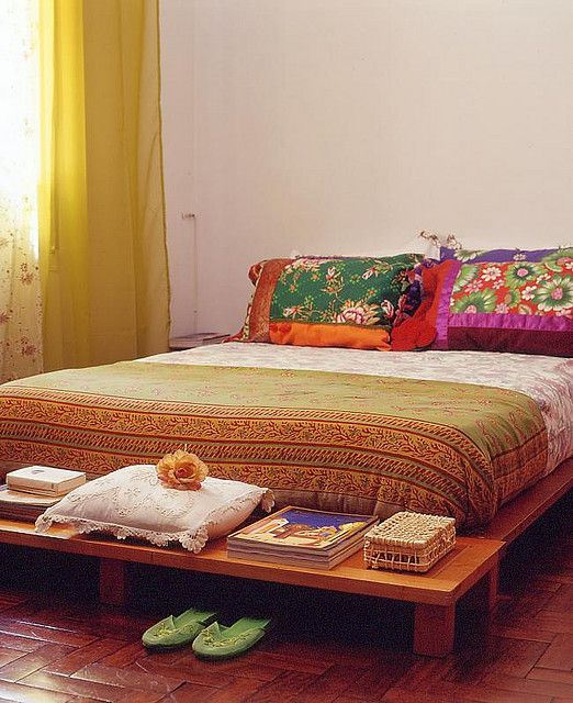 Simple, colorful, functional, and uncluttered. Everything I want a bed area to be.