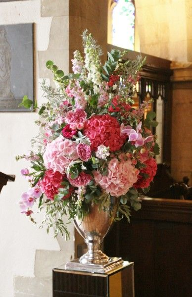If you need to move flowers from the church to the reception - use stunning vases, much easier to move!