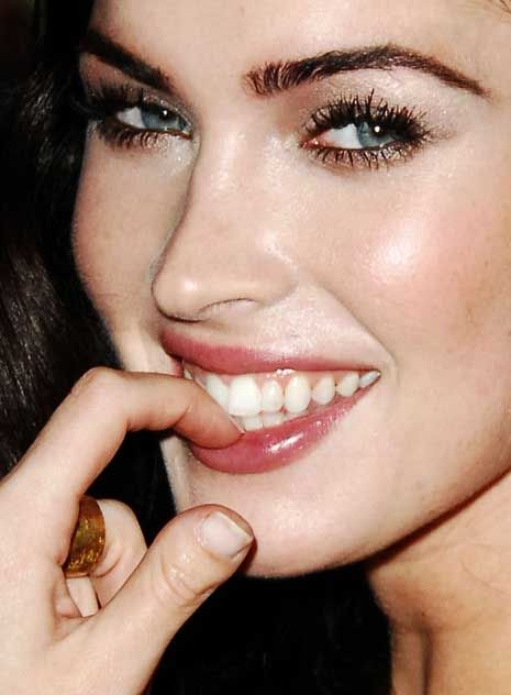 Megan Fox thumb close-up: her left thumb is featured with a short fingernail.