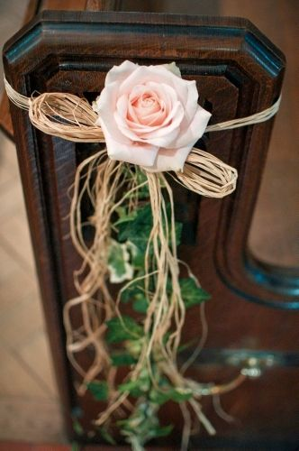 This is the pew ends we had at our wedding, simple avalanche rose, ivy & raffia