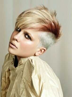 Short female mohawk in red and blond