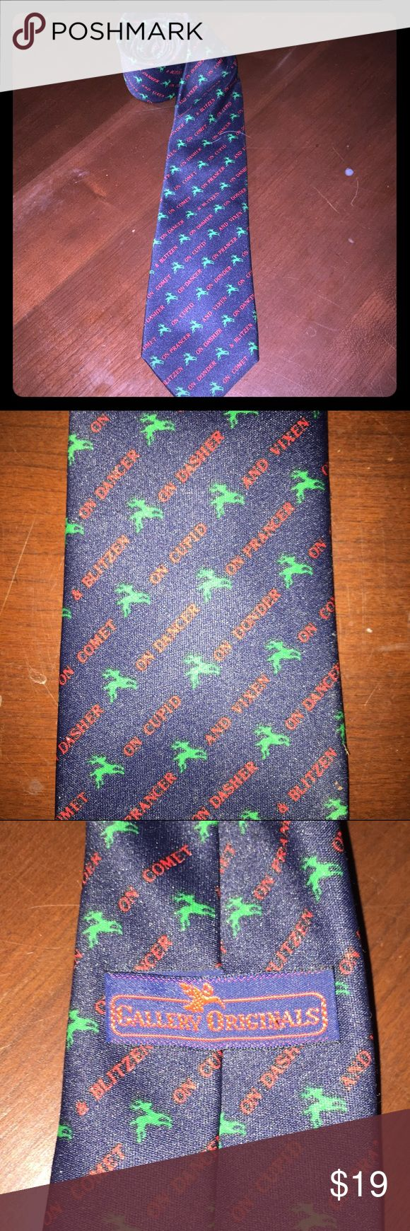 Christmas reindeer tie Blue tie with vibrant green reindeer & red writing. Has great pattern Dasher, Dancer, Prancer, Vixen, Comet, Cupid, Dunder (Donder and Donner), and Blixem (Blixen and Blitzen), & Rudolph great used condition holiday tie xmas tie Christmas tie Accessories Ties