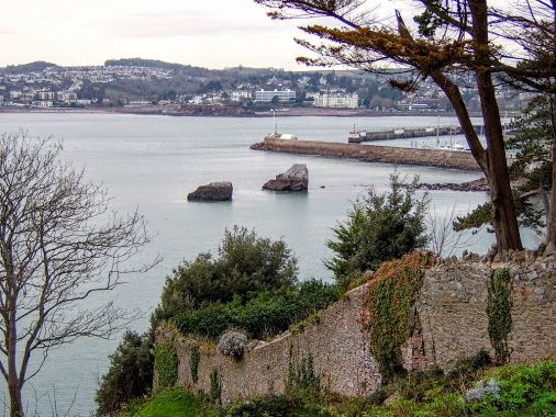 The Milestones from above Peaked Tor Cove, Torquay.  Torquay Harbour to the right, Livermead & Chelston in the distance.  #tw  -  Paul Hutchinson - Google+