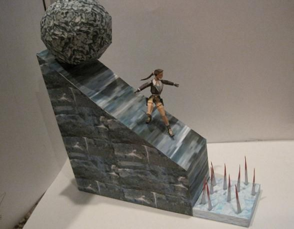 Tomb Raider 2 - Rolling Boulder Diorama - by Saschacraft      ==      A perfect collectible for any fan of Tomb Raider: a diorama depicting Lara Croft sliding down a slope to escape a boulder that is ready to crush her. A classic scene from Tomb Raider 2 videogame. This cool paper model was created by designer Saschacraft.