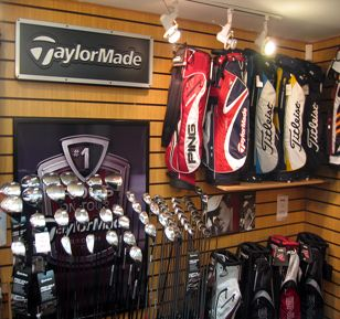 Small Golf Pro Shop | Paisley Golf Club Pro Shop -  bags lined up on wall and clubs mounted as well