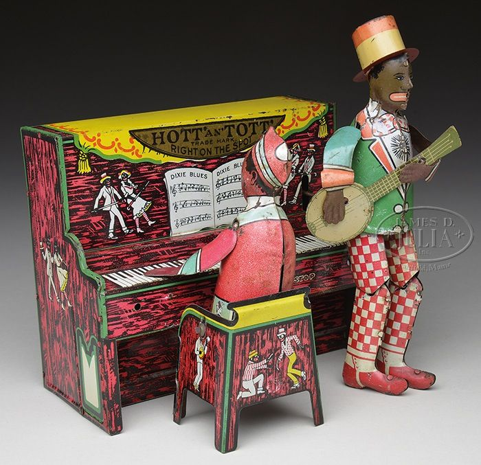 Ham & Sam - HOTT & TOTT PIANO BAND TOY. Originally this toy was manufactured and sold by Ferdinand Strauss as Originally this toy was manufactured and sold by Ferdinand Strauss as Ham & Sam, but at some point in time, Unique Art then sold the identical toy just placing decals over two spots that previously indicated Strauss as the maker.