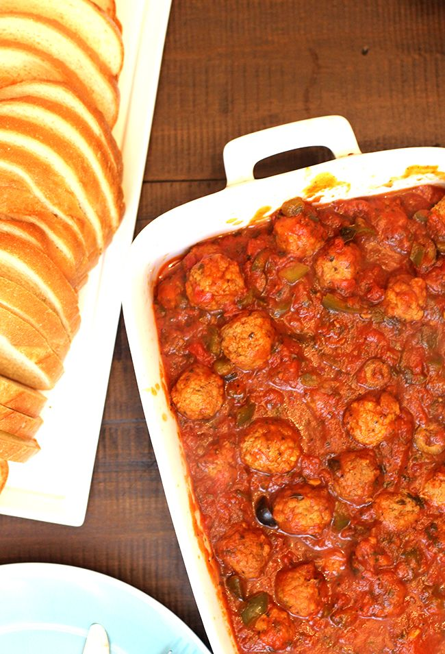 Toss frozen meatballs & marinara in your slow cooker for a DELISH meal. Serve over pasta!