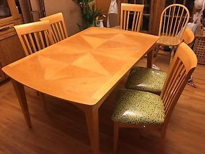 Solid oak table with 6 covered chairs