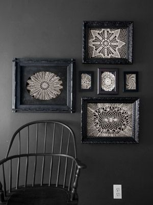 Using tape or tacks, secure vintage doilies to the open backs of black frames. The white crochet looks especially moody hung on a deep-hued wall.
