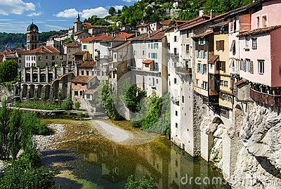 Typical view of traditional french town Pont en Royans, near Genoble, in the Vercors region. This is the famous old village centre with houses built over the river. The French Pre-Alps have a rich cultural heritage.