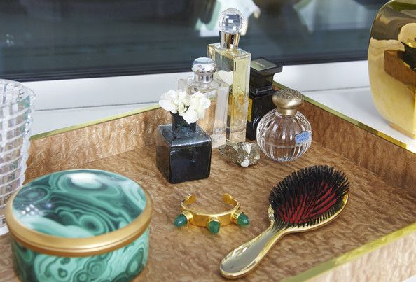 Modern Bathroom - Jewelry and beauty needs arrayed on a decorative tray