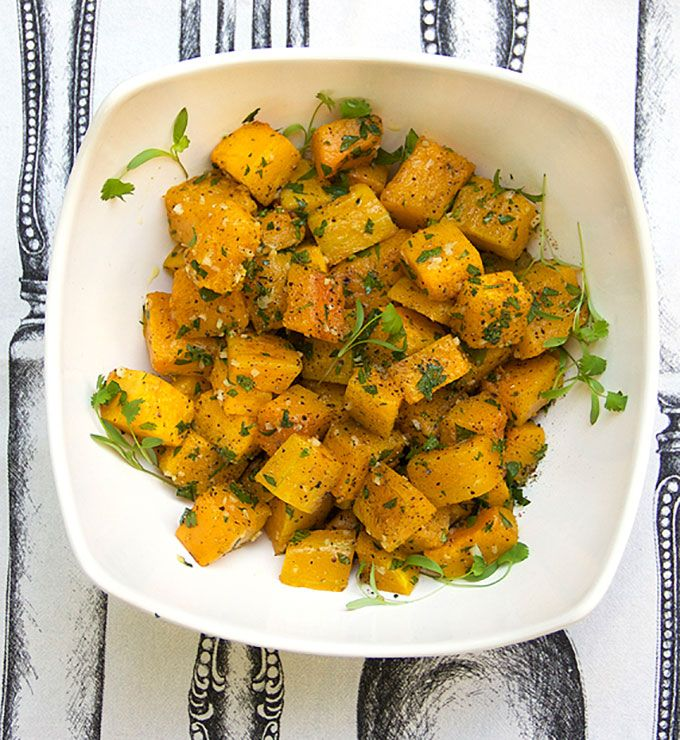 Garlicky Roasted Butternut Squash: roasted butternut squash cubes with garlicky olive oil - a perfect Fall/Winter side dish for the holidays or any time.
