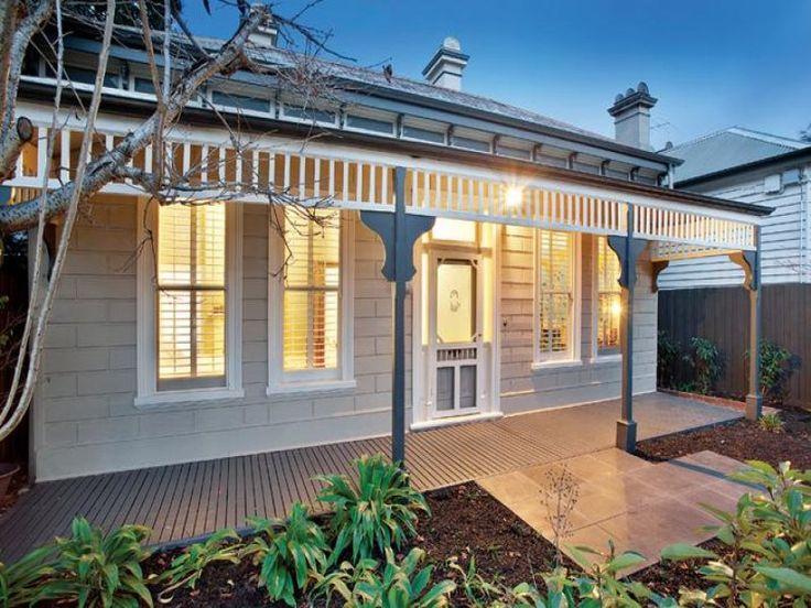 Brick victorian house exterior with porch  landscaped garden - House Facade photo 525453