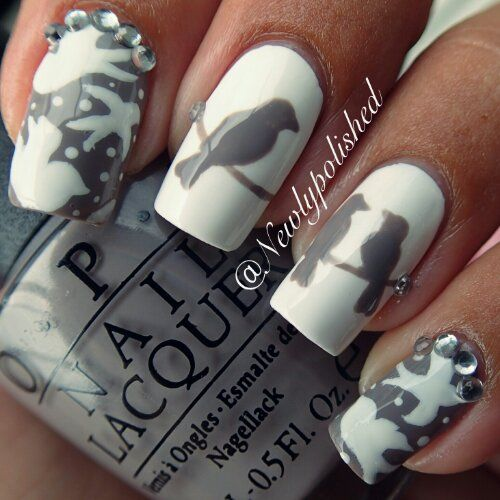 don't like the grey nails.... look like swimming penguins.  But I do like the simple silhouette on the white nails.