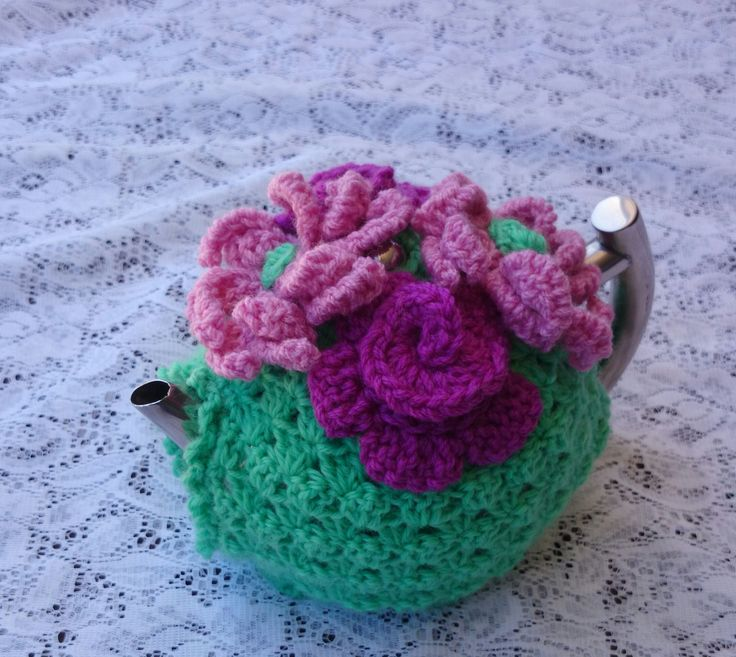 Handmade granny stitch crochet tea cosy topped with pretty flowers and made from Australian wool.